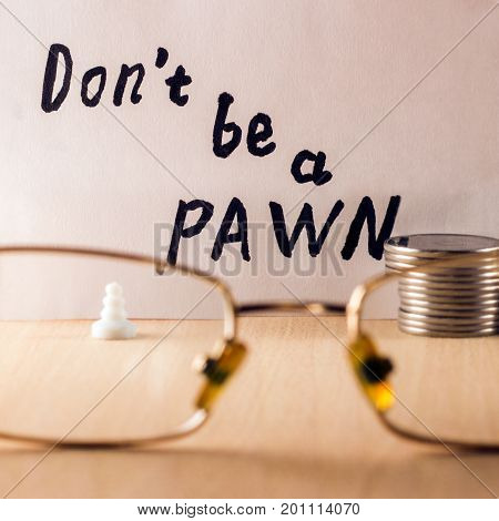 Do not be a pawn inscription in English The concept of poverty