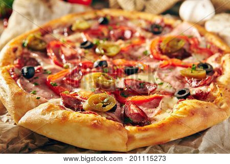 Pizza Restaurant Menu - Delicious Spicy Pizza with Sausages and Chili Pepper. Pizza on Rustic Wooden Table with Ingredients