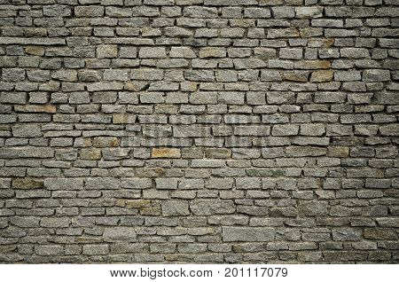 Large grey brick wall in the city
