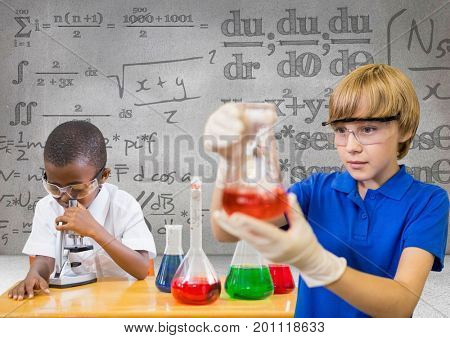Digital composite of Science kids with blank grey background with science equations graphics