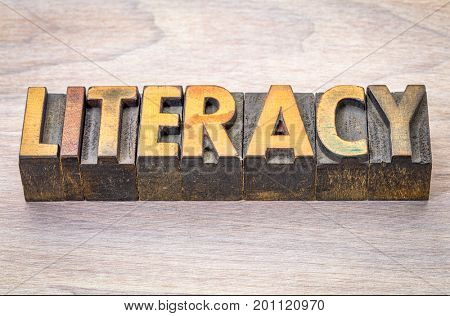 literacy word abstract in vintage letterpress woodtype printing blocks