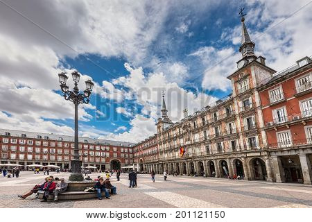 Madrid Spain - May 22 2014: People at the Plaza Mayor the central square in Madrid Spain. Architecture and landmark of Madrid.
