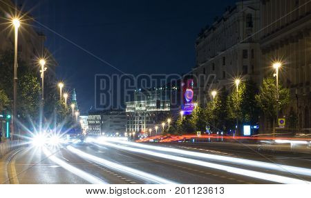 modern city street with lights and traffic at night. background city life.