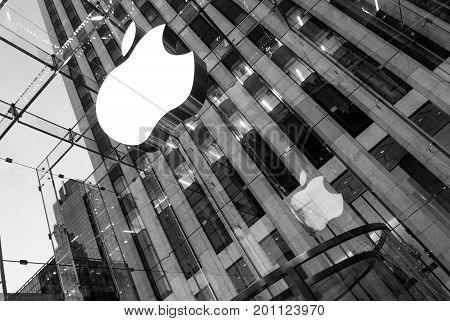 NEW YORK CITY - Dec 16, 2010:  Apple Store cube on 5th Avenue. Apple logo at Apple store on 5th ave. the glass front of the store looking up at logo in Manhattan, Dec 16, 2010 in New York City, USA.