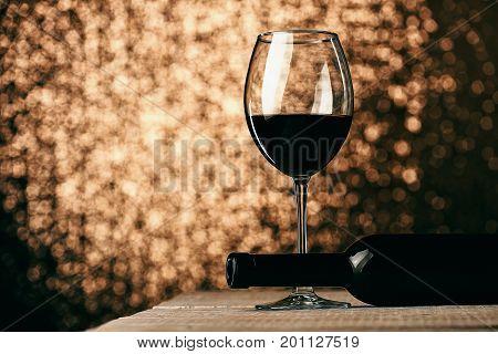 Glass Of Red Wine Near Lying Empty Bottle