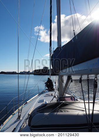 LOFOTEN ISLANDS, NORWAY-JULY 7, 2017. View of the yacht in Svolvaer marine Norway. Sailing yacht. Norwegian fjord. Natural landscape. Location: Lofoten Islands, Norway. White nights evening. A summer travel by the boat.