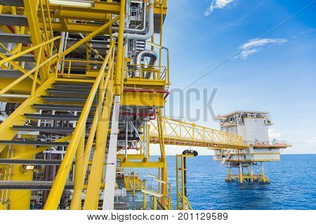 Oil and gas central processing platform at offshore stair way to go to each deck and bridge between accommodation platform