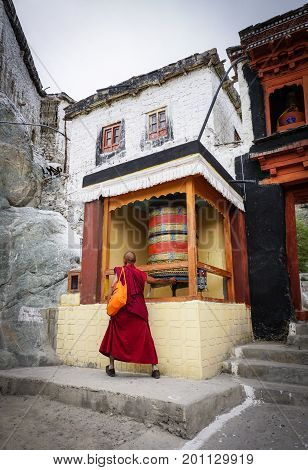Ladakh India - Apr 1, 2015. A monk praying at ancient Buddhist temple in Ladakh India. Ladakh is the highest plateau in the state of Jammu & Kashmir with much of it being over 3000m.