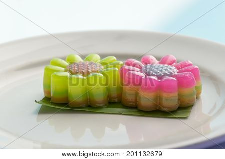 Bright flower Layer Sweet Cakes (Kanom Chan) on banana leaf