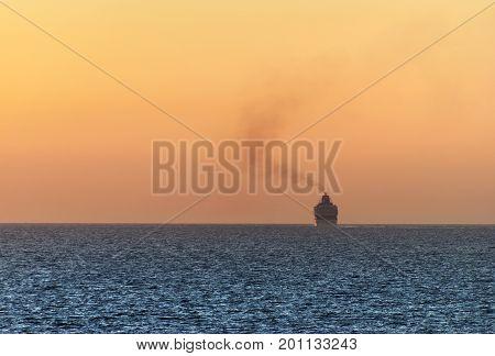 The cruise liner leaving Roatan island at dusk (Honduras).