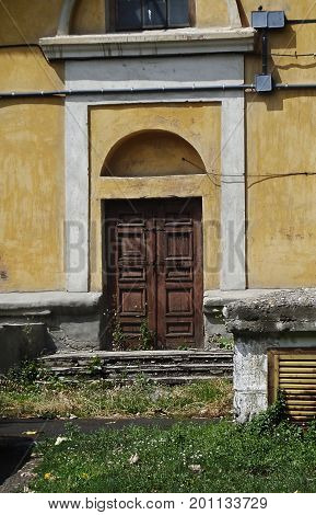 Kazakhstan, Ust-Kamenogorsk - 01, August 2017. The door of the old house. Architecture. Ancient architecture. Architectural background. Door. Front door. Old door.