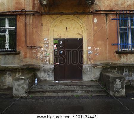 Kazakhstan, Ust-Kamenogorsk - 01, August 2017. The front door to the entrance. Architecture. Ancient architecture. Architectural background. Door. Front door. Old door.
