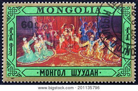 MONGOLIA - CIRCA 1987: a stamp printed in Mongolia shows Folk Dance circa 1987