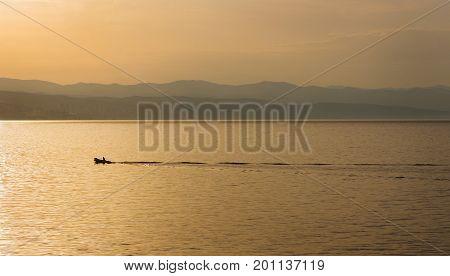 A boat at sunrise in Opatija Croatia