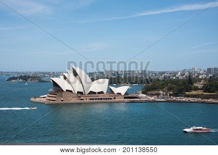 SYDNEY,NSW,AUSTRALIA-NOVEMBER 20,2016: Sydney Opera House at Bennelong Point with jet boat, sailboats and cruise tour in Sydney, Australia