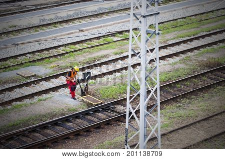 Railroad switch. Railwayman using switch. Train infrastructure