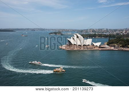 SYDNEY,NSW,AUSTRALIA-NOVEMBER 20,2016: Sydney Opera House, harbour, military ship and residential architecture in Sydney, Australia