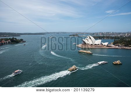 SYDNEY,NSW,AUSTRALIA-NOVEMBER 20,2016: Sydney Opera House at Bennelong Point with nautical vessels and waterfront housing in Sydney, Australia