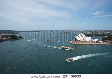 SYDNEY,NSW,AUSTRALIA-NOVEMBER 20,2016: Sydney Opera House at Bennelong Point with harbour traffic in Sydney, Australia