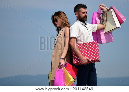 Sexy Girl And Guy With Serene Faces Make Purchases