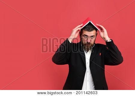 Man In Classic Suit With Beard Holds Book On Head