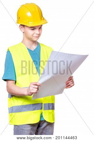 Emotional portrait of handsome caucasian teen boy wearing safety jacket and yellow hard hat. Happy child holding and reading a plan, isolated on white background.