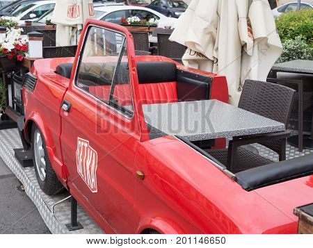 WROCLAW POLAND - AUGUST 16 2017: Car With Table And Chair At A Restaurant In Wroclaw