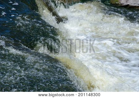seething water on a mountain river threshold