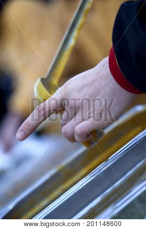 Close Up Of Hand Serving Soup In A Ladle