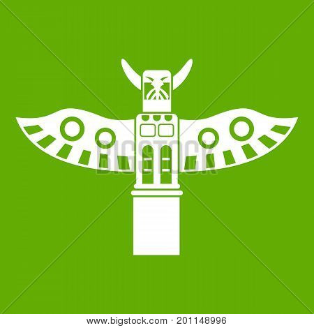 Traditional religious totem pole icon white isolated on green background. Vector illustration