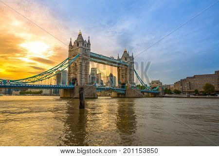 Famous Tower Bridge in the evening with sunset sky and reflex on water London England