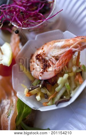 Shrimp, Salad And Vegetable On Bowls In A Bistro