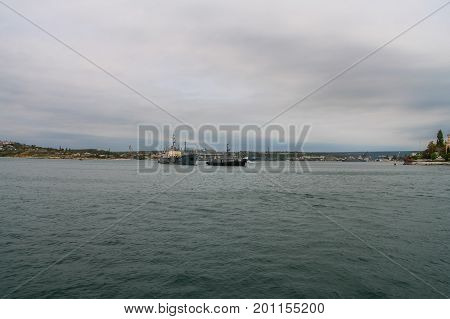 "Raid tug ""RB-247"" pulls a small sea tanker ""VTN-99"" of the Chernomorsky naval fleet in the bay of Sevastopol. Crimea Ukraine. May 2009 poster"