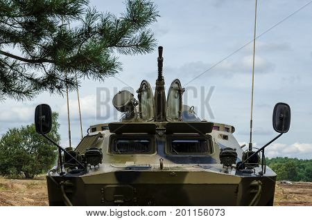 ARMORED RECONNAISSANCE CAR - A military vehicle in the field