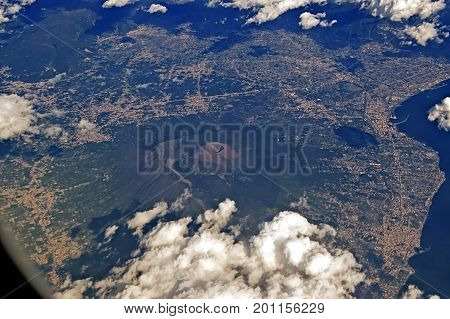 View of Mount Vesuvius and the seafront from the plane, Italy