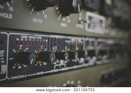 Studio equipment for recording and mixing. Compressor. Selective focus.