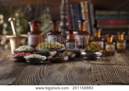 Wooden table, shallow depth of focus. Chinese medicine concept. Macro shot.