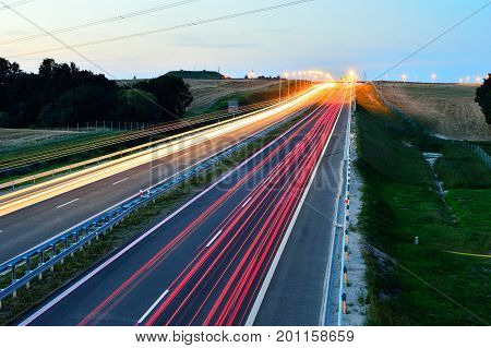 Highway and cars during traffic in day and night