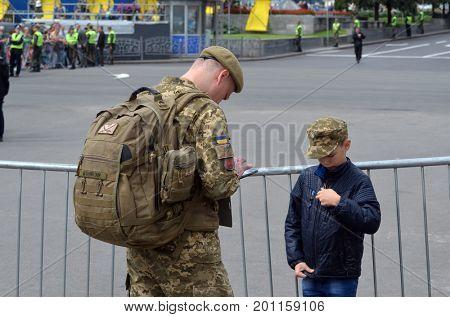 An unidentified person wears modern Ukrainian nazionalist battalion uniform. Celebration of the Great Victory near Illovaysk.Downtown of Kiev..August 22, 2017 Kiev, Ukraine