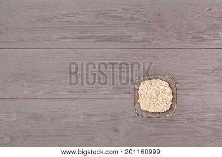 Plate of porridge on wooden gray table top view. healthy breakfast top view of wholesome food with space for text