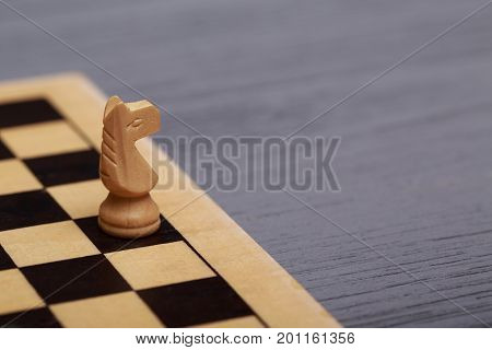 table with a chessboard and chess pieces. game process. Top view on table with chessboard