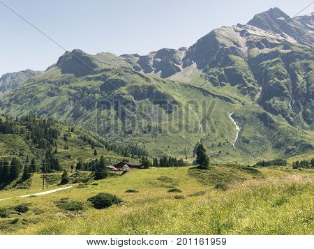 Scenic Alpine rocky alpine valley of Sportgastein in summer. Picturesque mountain pasture lands, great mountain massif and sunny weather. Sport hiking landscape background.