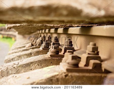 Selective Field Of Focus. Detail Of Rusty Screws And Nut On Old Railroad Track