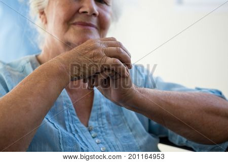 Close up midsection of senior woman sitting in nursing home