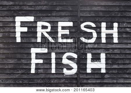 Fresh Fish sign on a hut on The Stade Hastings UK