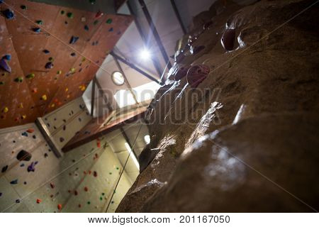 Low angle of wall with footholds in fitness studio