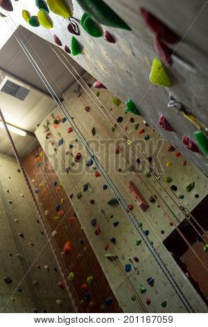 Wall with colorful footholds in fitness studio