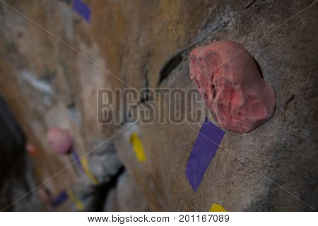 Close-up footholds on wall in fitness studio