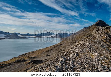Mountain range and glaciers under the clouds in Svalbard