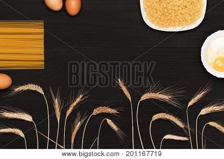 Wooden table top view. On the table are the food for cooking. Healthy food. Dietetic foods. Above view on food.